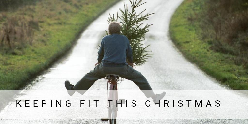 Cyclist with Chrismas tree on bike